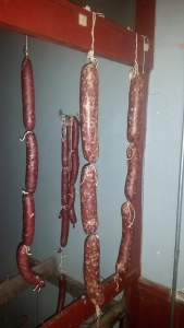 Salami curing in the back hallway.